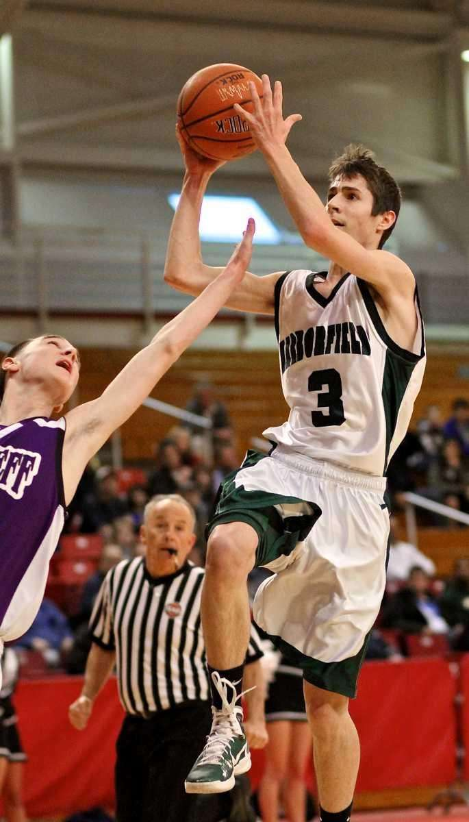 Harborfields guard Billy Turner #3 goes up for
