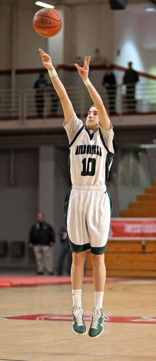 Harborfields guard Lucas Woodhouse #10 goes up for