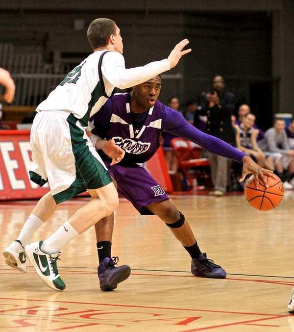 Port Jefferson guard Terell Rose #4 moves into