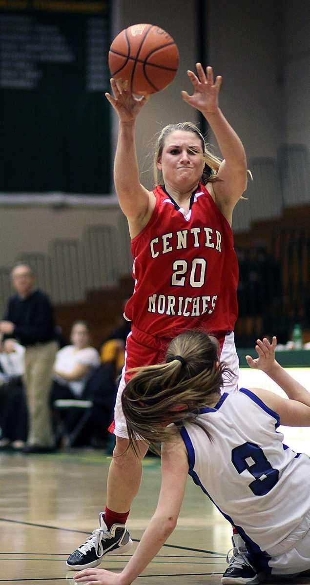 Center Moriches Emma Whittle fires pass over a