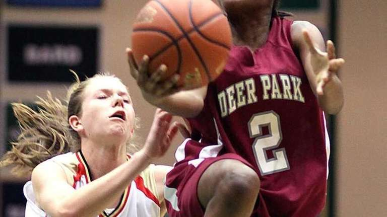 Deer Park's Andrea Desvignes gets past Katie Doherty