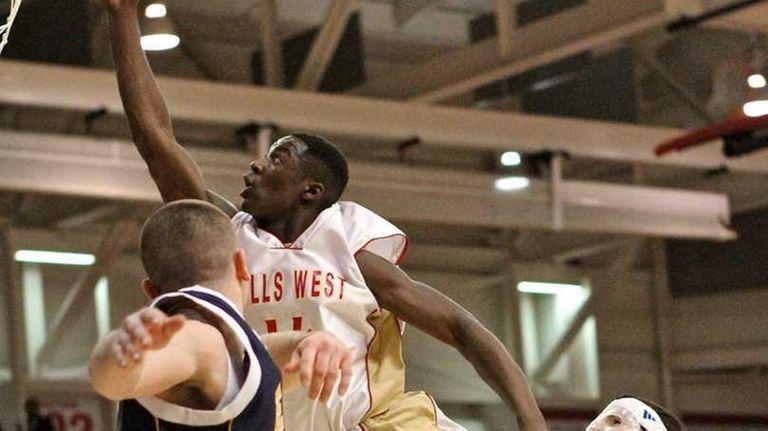 Hills West guard Chris Cox #14 puts in