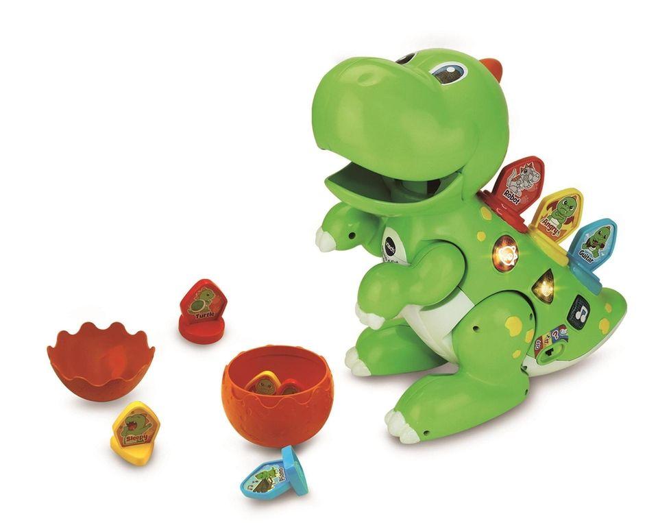 Insert the tiles on the bright green dinosaur's