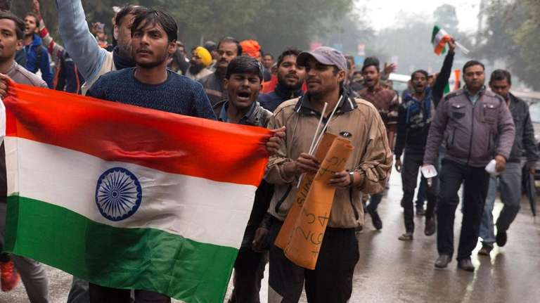 Indian protesters shout slogans against Thursday's attack on
