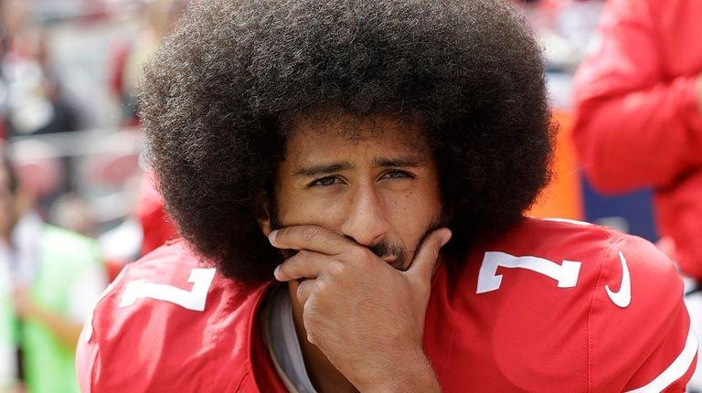 Then-San Francisco 49ers quarterback Colin Kaepernick kneels during