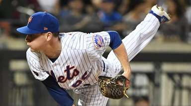 Mets relief pitcher Drew Smith delivers against the
