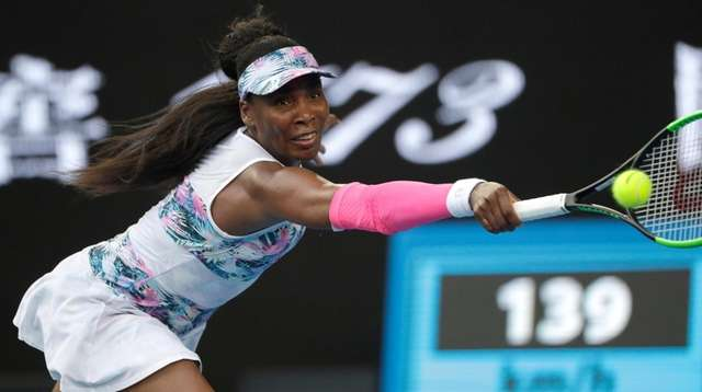 United States' Venus Williams reaches for a backhand