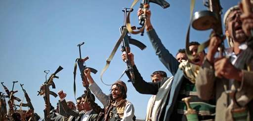 Tribesmen loyal to Houthi rebels hold up their