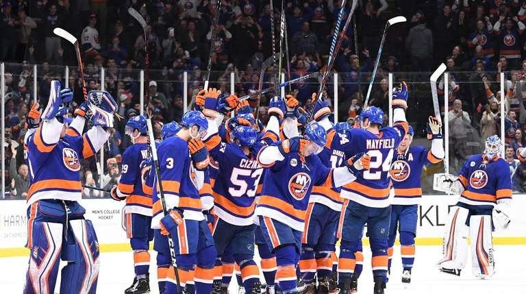 Islanders players celebrate their 3-2 win against the