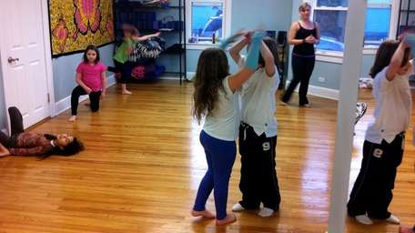 Kids participate in Wee Warriors Yoga Playtime in