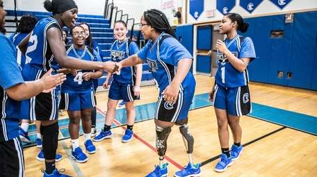 Amaya Williams is congratulated by her teammates after