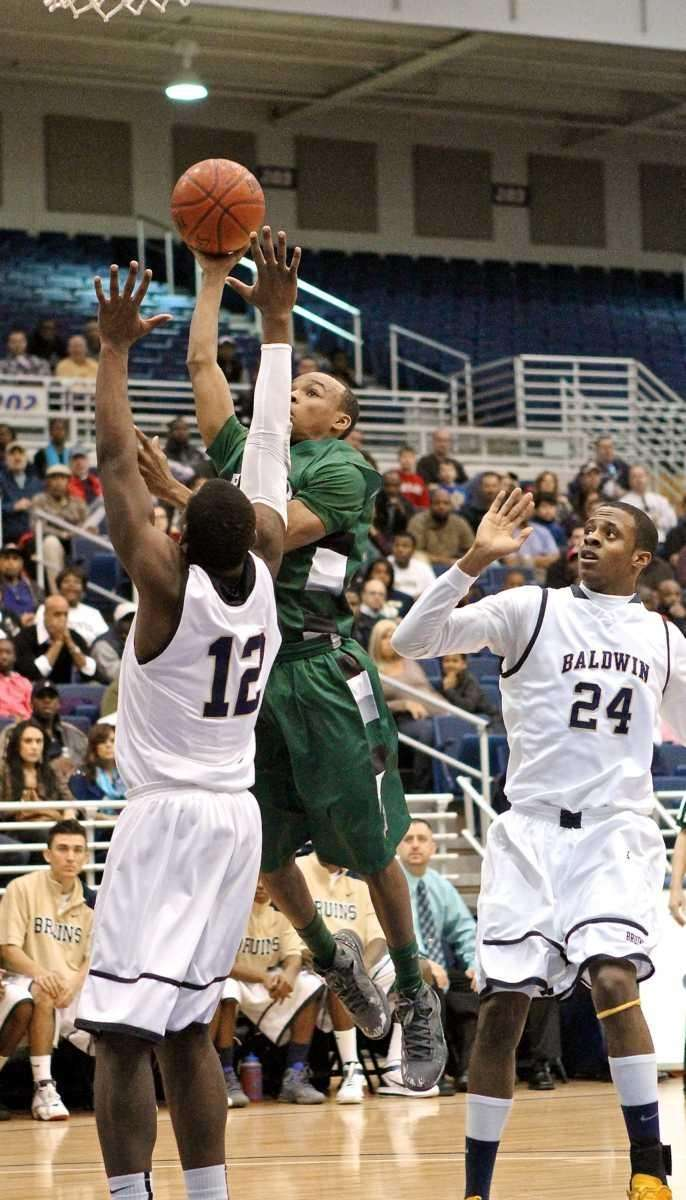 Elmont guard Robert Chambers #1 puts in the