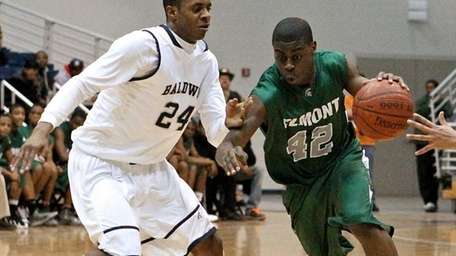 Elmont guard Devin Guerre #42 drives the zone