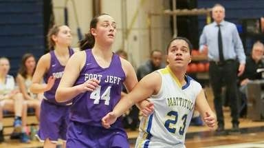 Mattituck's Jaden Thompson (23) and Port Jefferson's Abigail