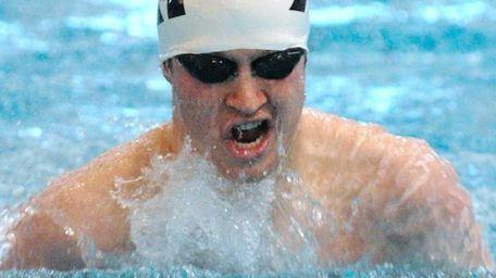 Matthew Goetz of Islip performs the breaststroke portion