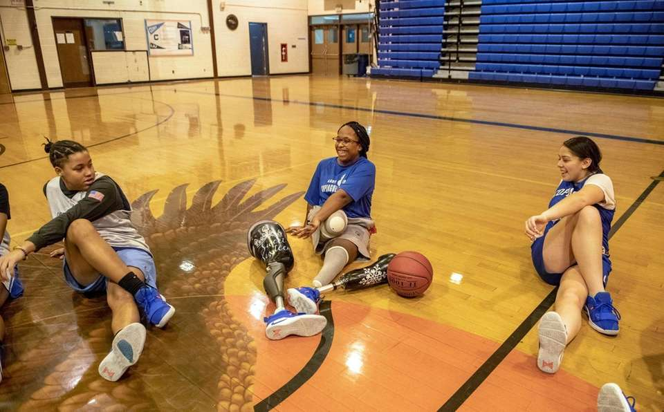 Amaya Williams joins her teammates as they stretch