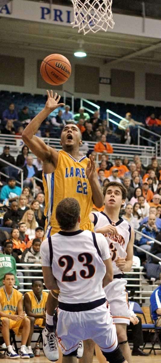 Lawrence guard Ibraheem Shamseldin #22 goes over Manhasset
