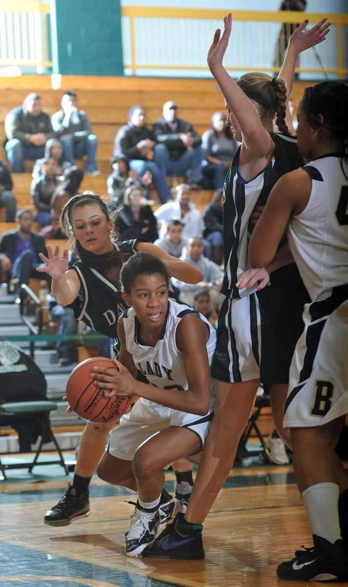 Baldwin senior Courtney Jackson (22) keeps possession of