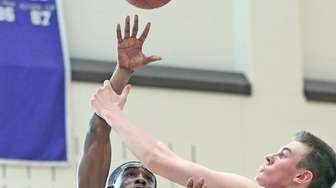 Sewanhaka's Joseph Hicks tries the shot during the