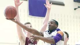 Sewanhaka's Joseph Hicks goes to the hoop during