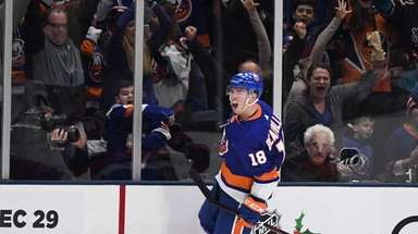 Islanders left wing Anthony Beauvillier and fans celebrate