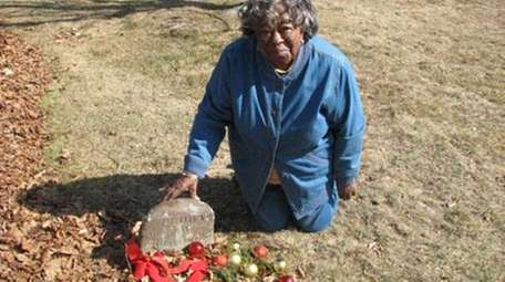 Eleanor Lingo, 84, of Southold, visits the grave
