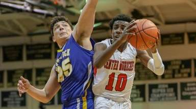 Dayrien Franklin #10 of Center Moriches goes up