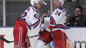 New York Rangers' Ryan Callahan, right, celebrates his