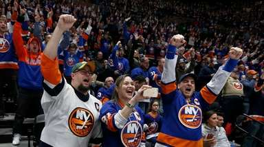 Fans cheer an Islanders goal in the third