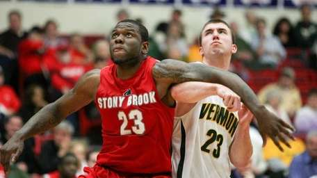 Brian Voelkel of Vermont is boxed out by
