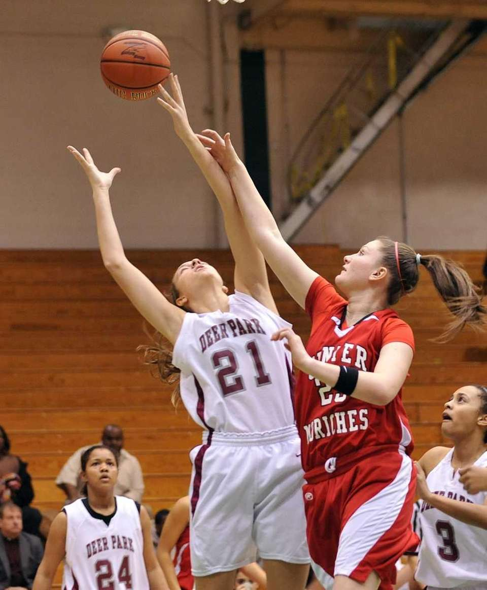Kelsey Glanzman of CM knocks the ball from