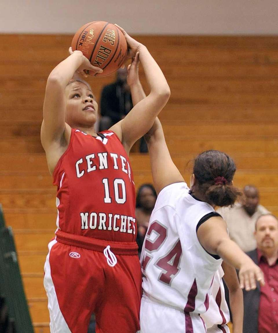 Loren Smith of Center Moriches is fouled while