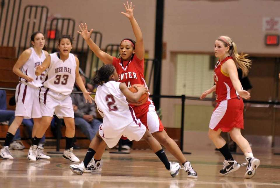 Venessa Lewis of Center Moriches plays tight defense