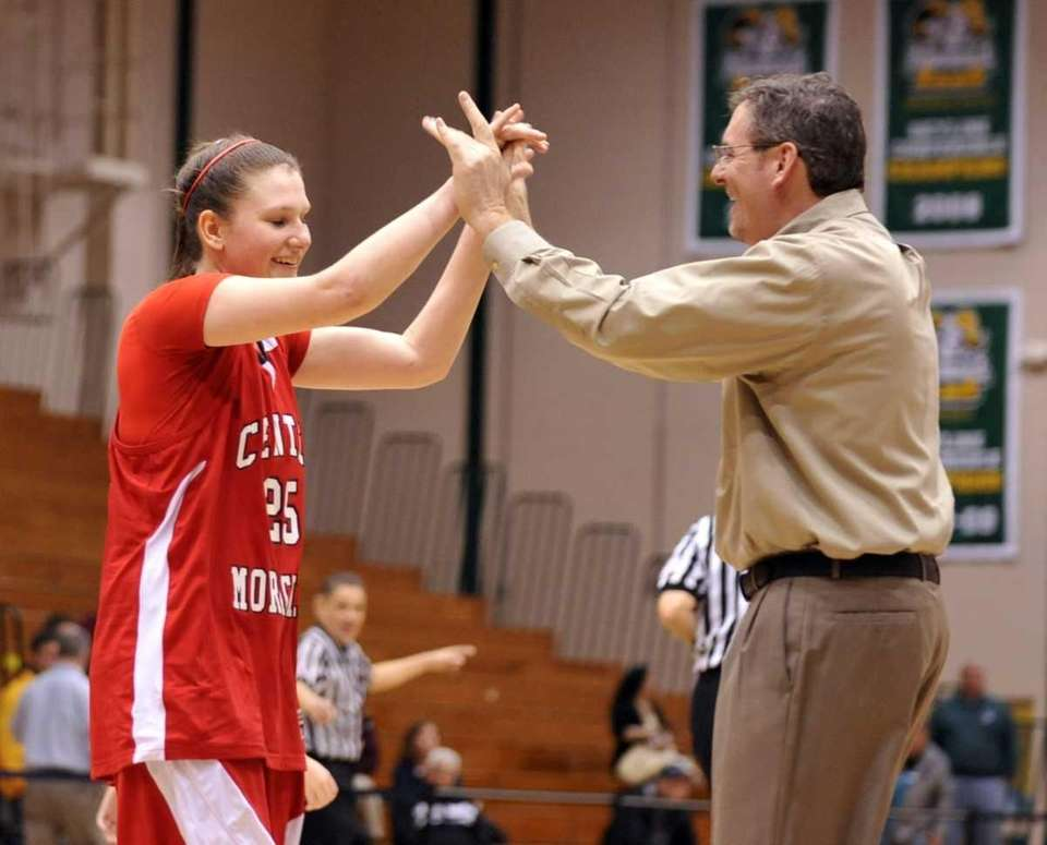 Kelsey Glanzman of Center Moriches is congratulated for
