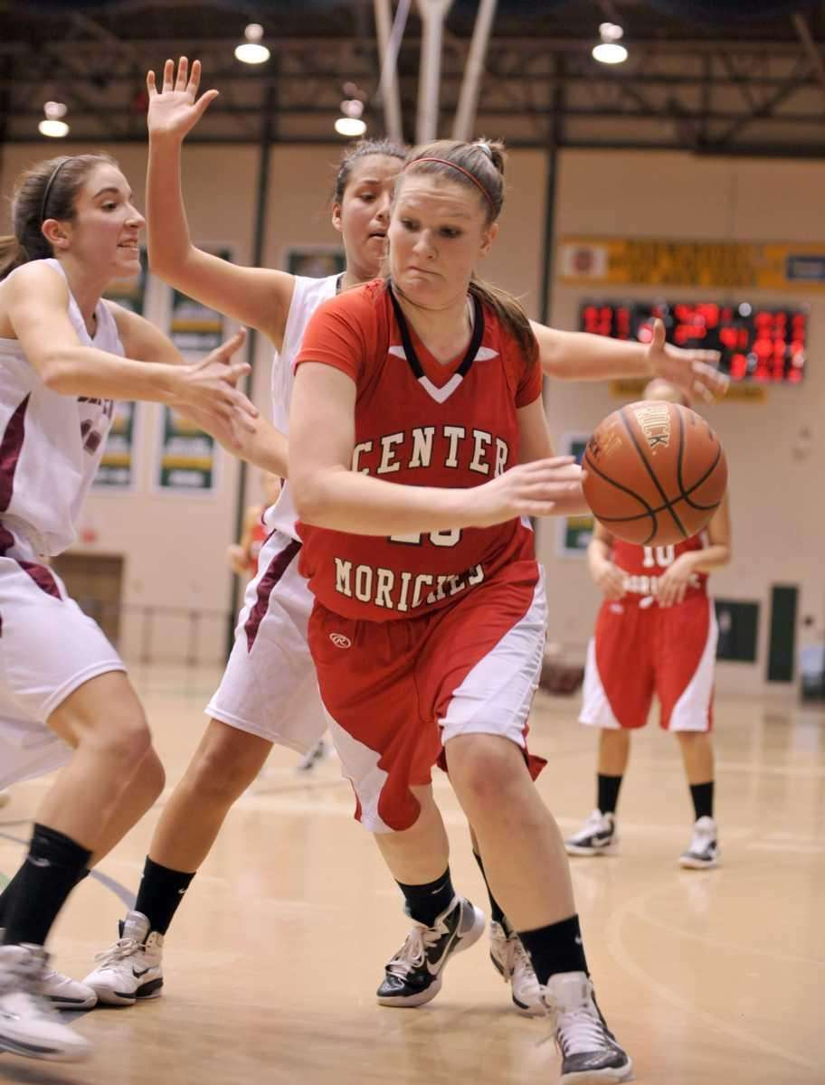 Kelsey Glanzman of Center Moriches drives past Deer