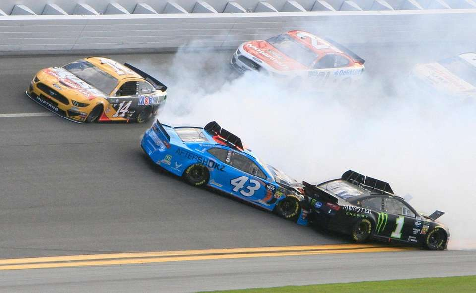 Darrell Wallace Jr. (43) gets caught up in
