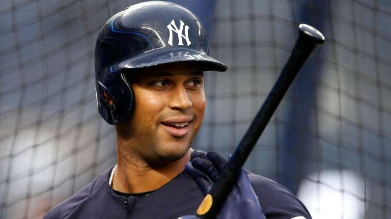 Aaron Hicks #31 of the Yankees looks on