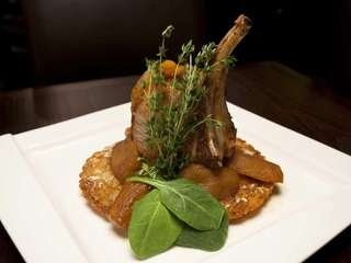 The oven roasted pork chop is served with