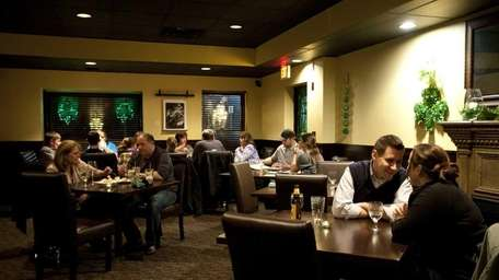 Patrons dine in the main dining room at