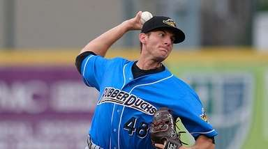 Kyle Dowdy pitches for the Akron RubberDucks at