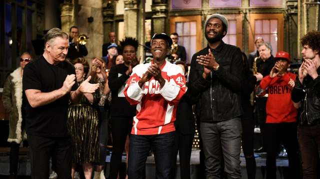 Alec Baldwin, left, host Don Cheadle and musical