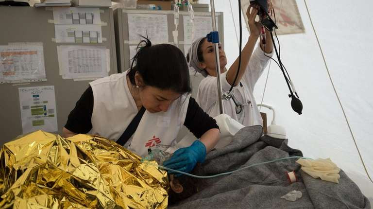 Valerie Gruhn, right, serving with Doctors Without Borders