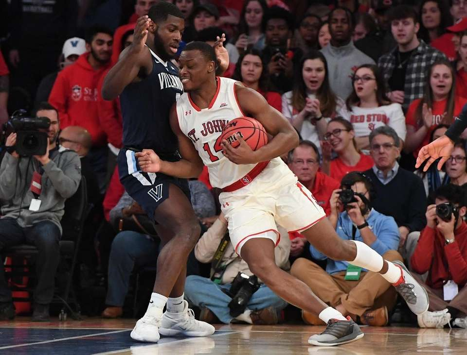 St. John's guard Mustapha Heron drives the ball