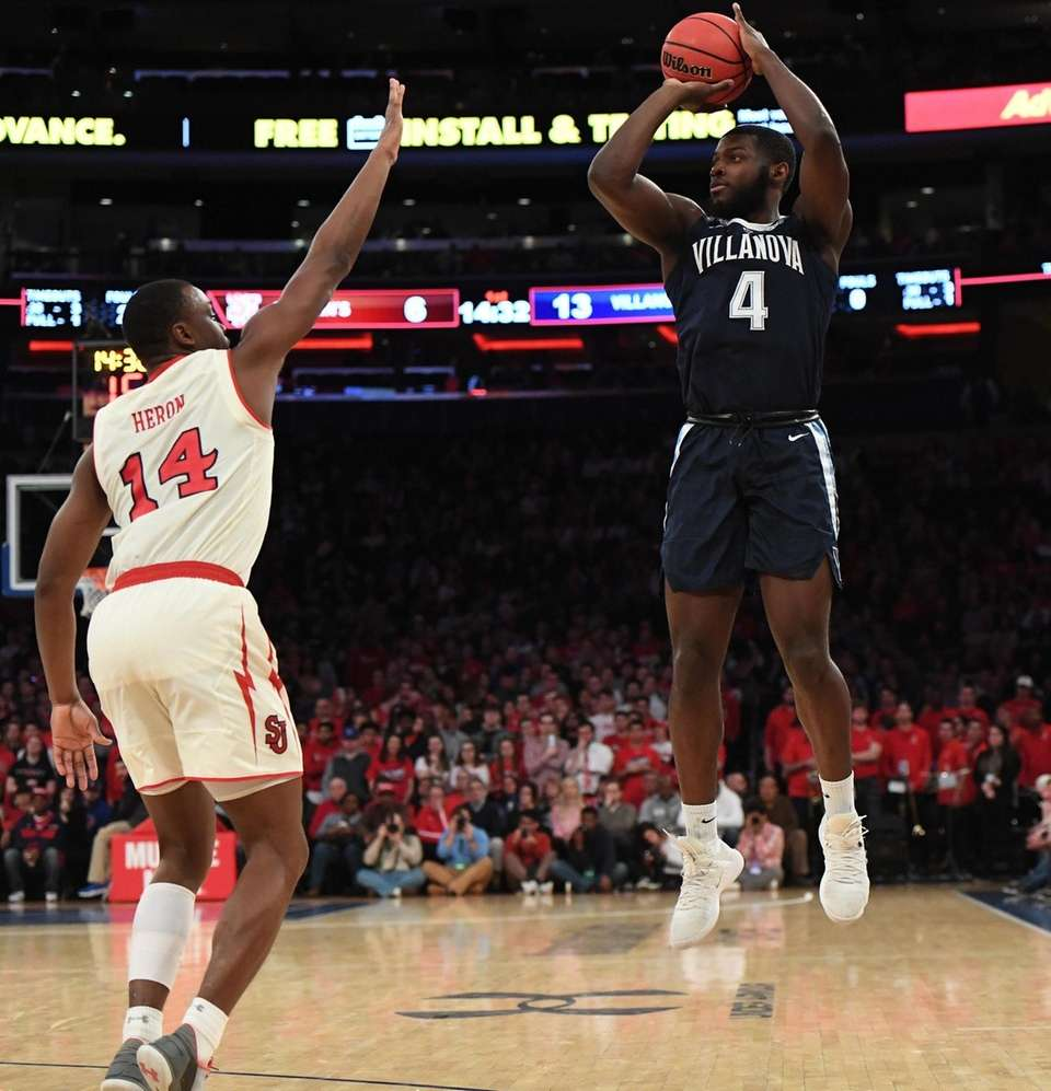 Villanova forward Eric Paschall puts up a three-point