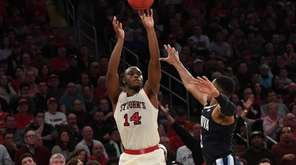 St. John's guard Mustapha Heron shoots for a