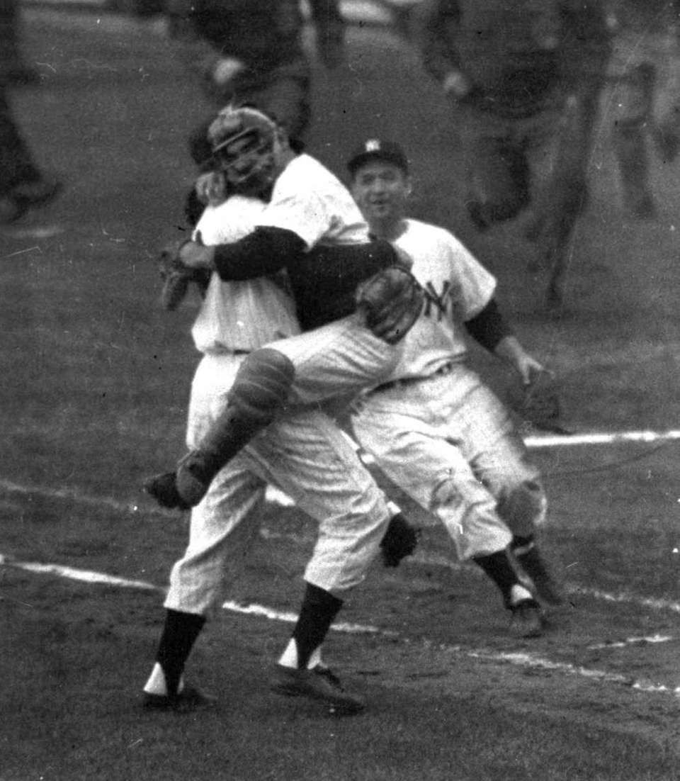 Yankees catcher Yogi Berra embraces pitcher Don Larsen
