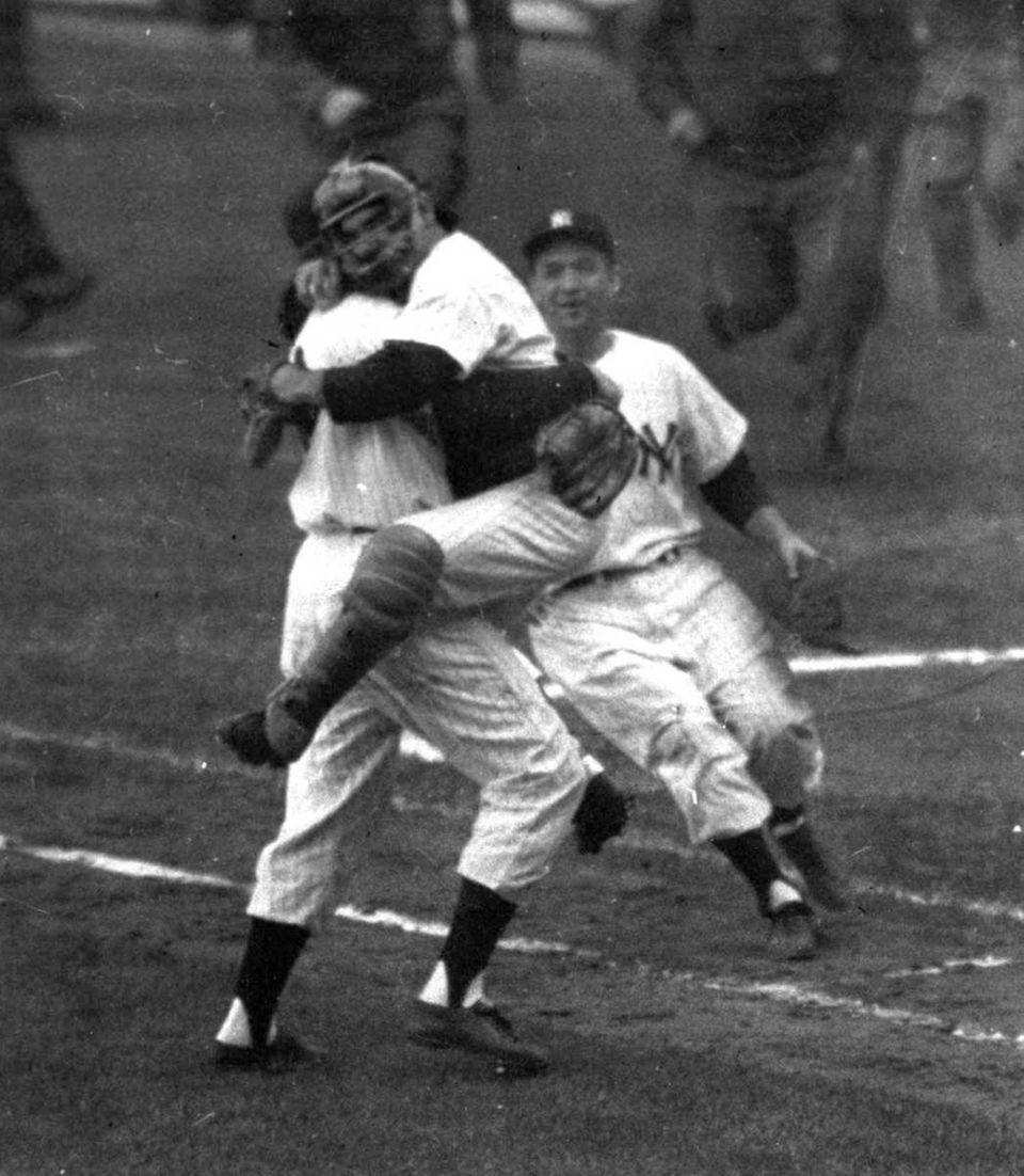 Yankees catcher Yogi Berra embraces pitcher Don Larsen