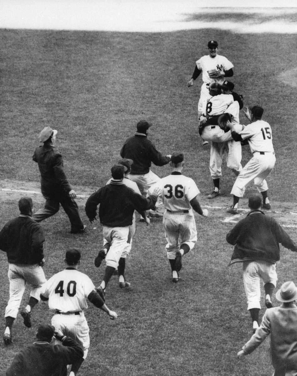 Yankees catcher Yogi Berra (8) jumps into the