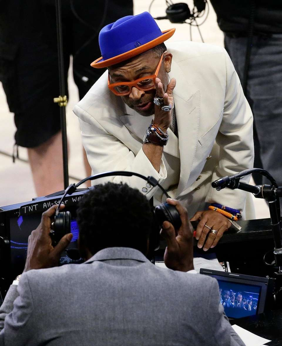 Director Spike Lee speaks with a person on