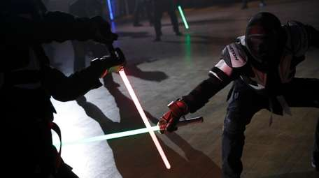 Competitors battle during a national lightsaber tournament in